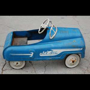 This toy pedal car is in very nice original condition. Structurally