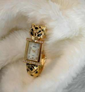 JAGUAR~AUSTRIAN CRYSTAL GOLD TONE LADIES BANGLE WATCH