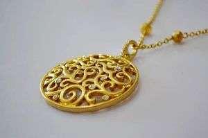 Carolee Cutout Circle Round Pendant Gold Tone Necklace