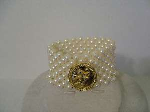 FAUX PEARL STRETCH BRACELET WITH GOLD CHERUB MEDALLION JEWELRY