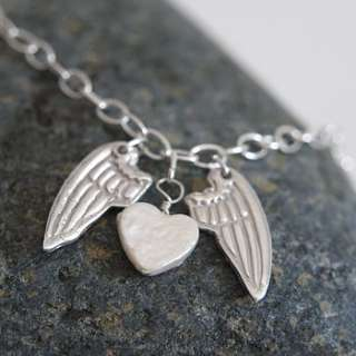 personalised silver mini angel wing necklace by dizzy