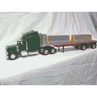 Peterbilt Spread Axle Flatbed w/ Jersey Barriers : Toys & Games