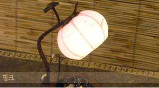 white red light orange light green pink many different paper lamps